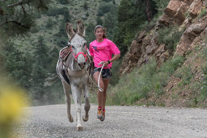 There were several kids running their burros.